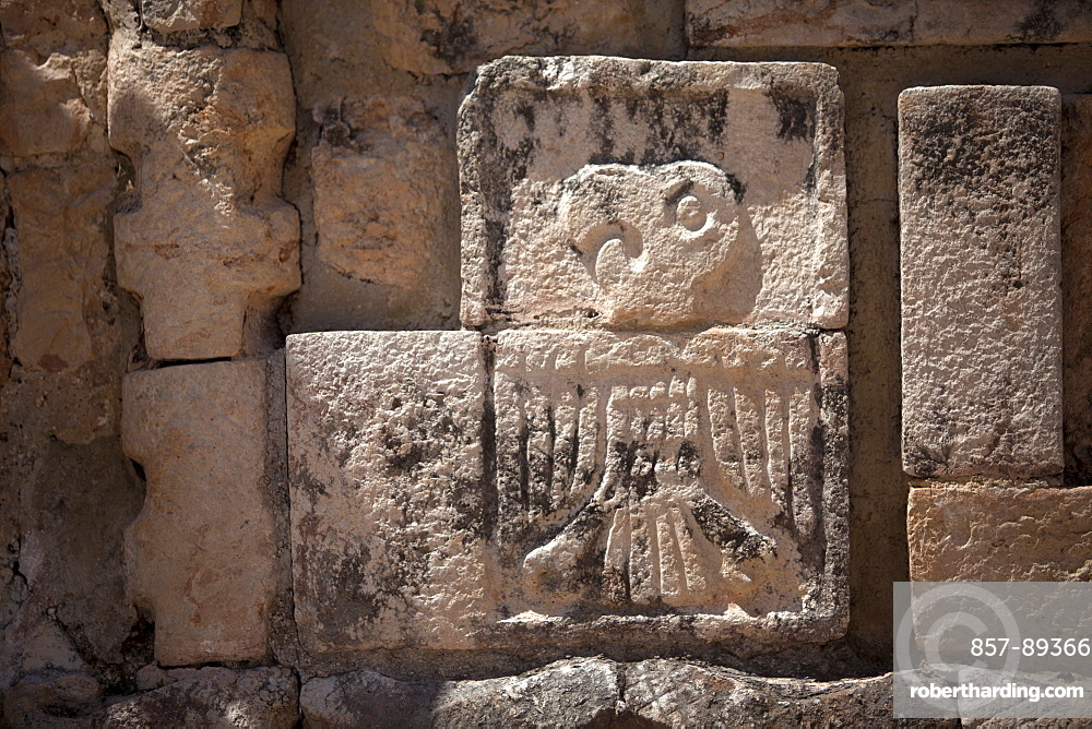 A stone relief with the image of a Guacamaya decorates a temple in the Mayan city of Uxmal, Yucatan Peninsula, Mexico
