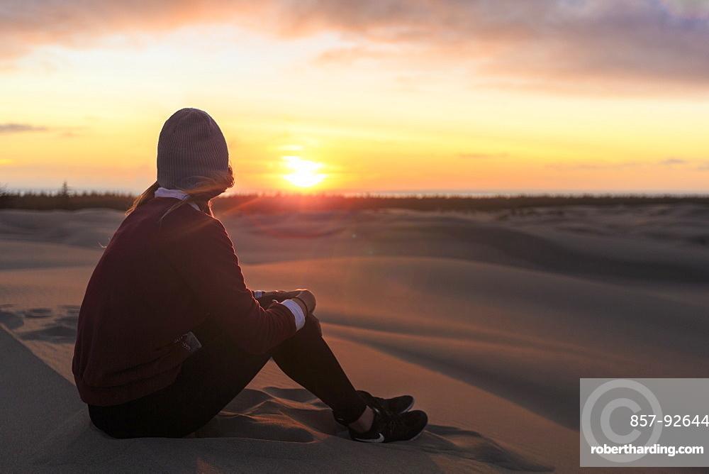 Woman watches sunset