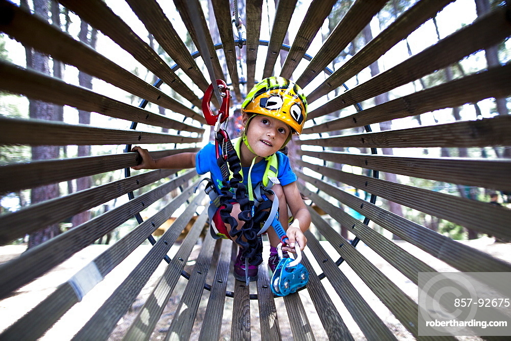 A 5 years old girl in an adventure park in Corsica.