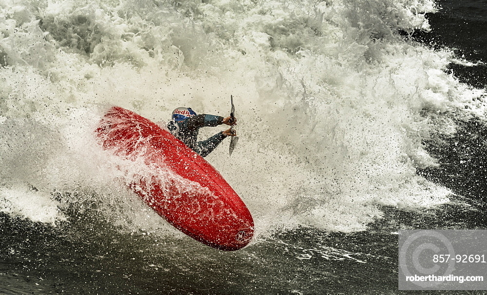 Spanish kayaker Aniol Serrasolses is riding the waves of the spanish coast with a freestyle kayak.