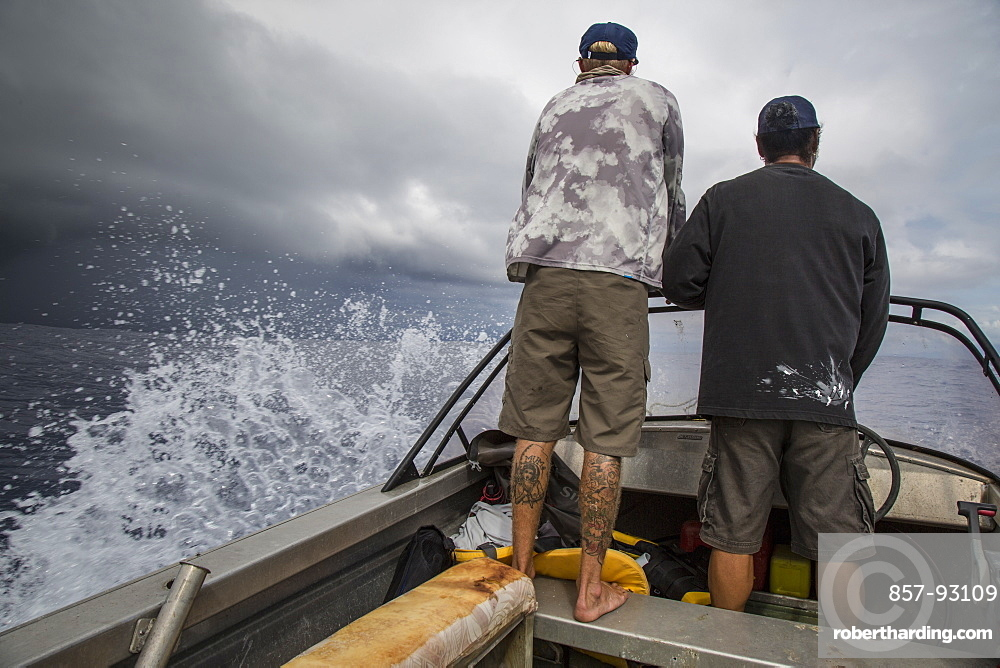 Angler Jonathan Jones and Fatu, a Samoan local, try to outrace an impending storm while fishing off the coast of Samoa.