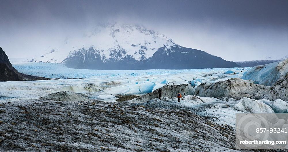Long exposure of person trekking on the  Sheridan Glacier