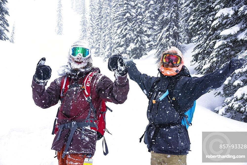 Two Happy Friends Enjoying In Snowy Region During Snow In Revelstoke, British Columbia, Canada