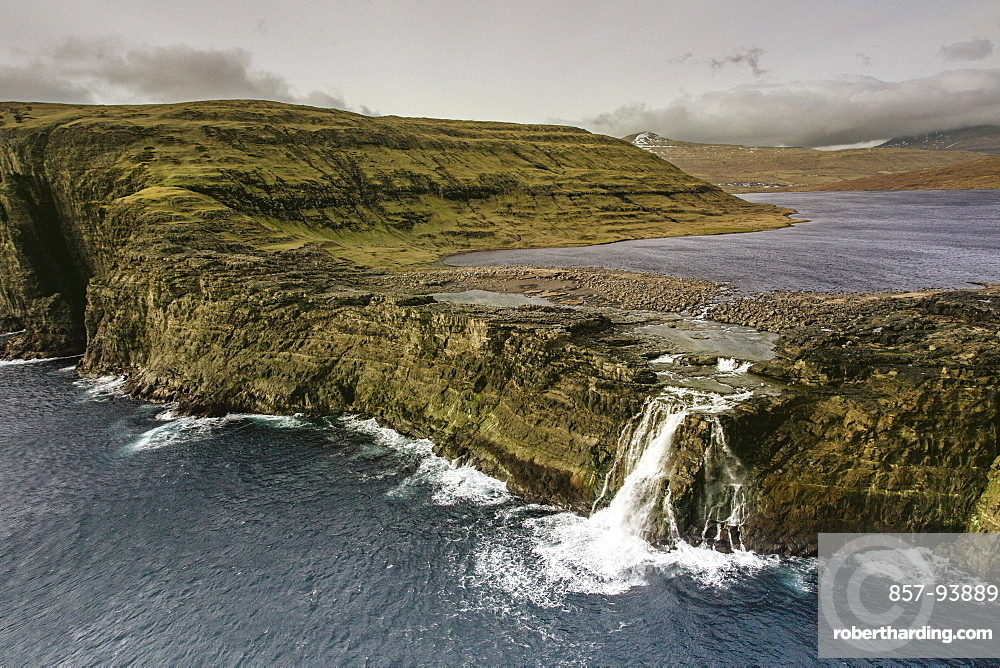 Bosdalafossur Waterfall Which Flows From Sorvagsvatn Directly Into Atlantic Ocean