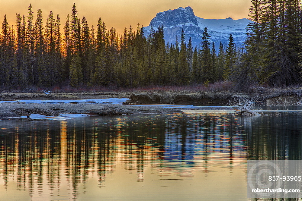 Mountain reflected in lake, sunset