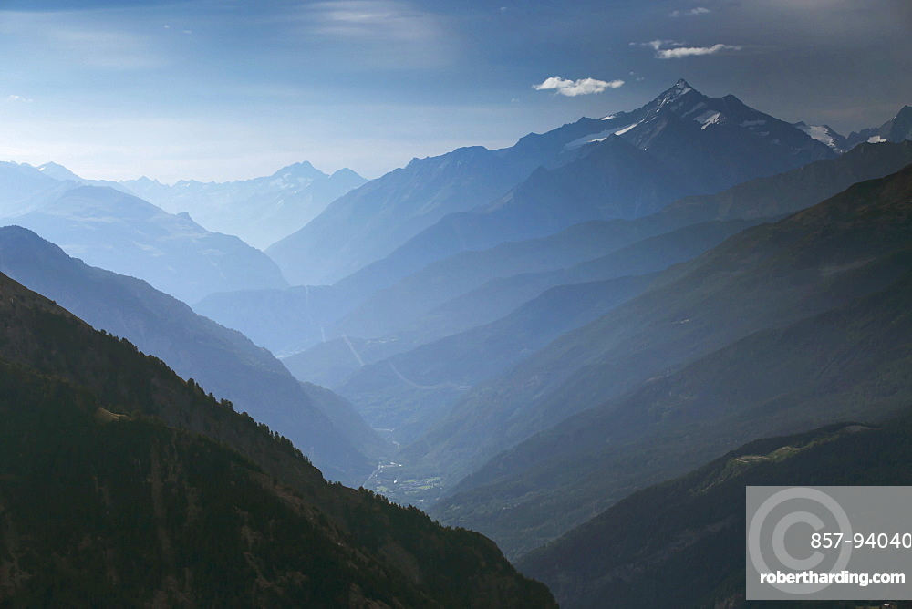 Mountain Ridges Of The Aosta Valley At Italy In The Morning Mist