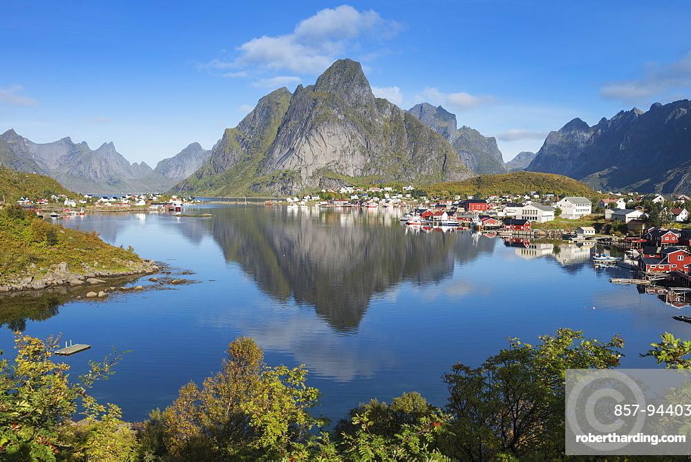 Reflection of Olstind mountain peak in Reine harbor, Moskenesøy, Lofoten Islands, Norway