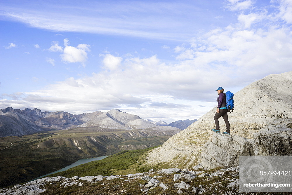 Female hiker at viewpoint on Stone Mountain British Columbia in the Northern Rockies