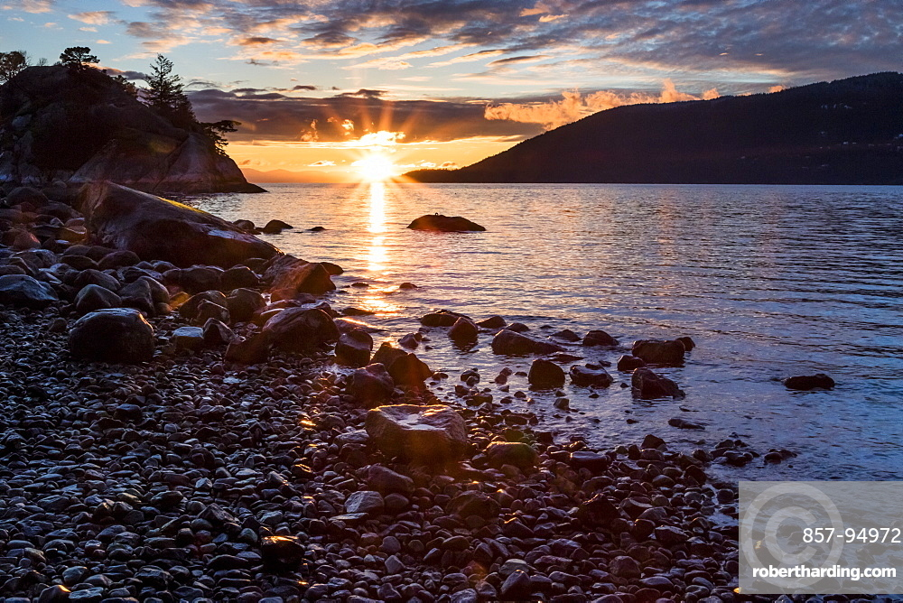 The sun sets on a winter night of the ocean as seen from Whytecliff Park in West Vancouver, British Columbia.
