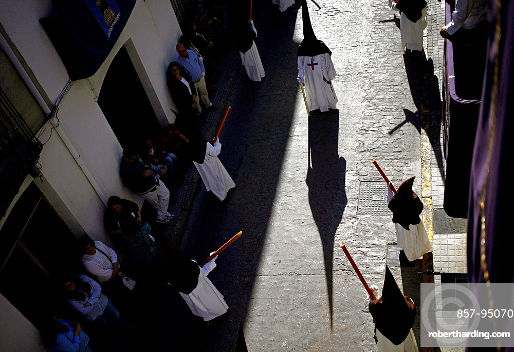 Shadow of penitente during Easter Week celebrations in Baeza, Jaen Province, Andalusia, Spain