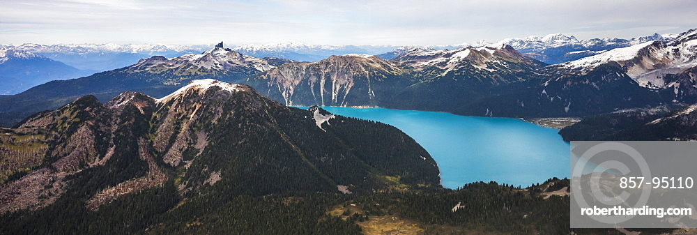 Garibaldi Lake in British Columbia, Canada. An turquoise colored alpine lake that is surrounded almost entirely by mountains. Iconic Black Tusk, the remains of a strato volcano can be seen in the background.