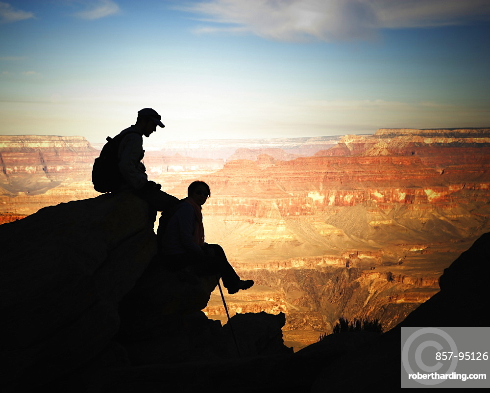 Silhouettes of a male and female hiker, Grand Canyon National Park, Arizona.