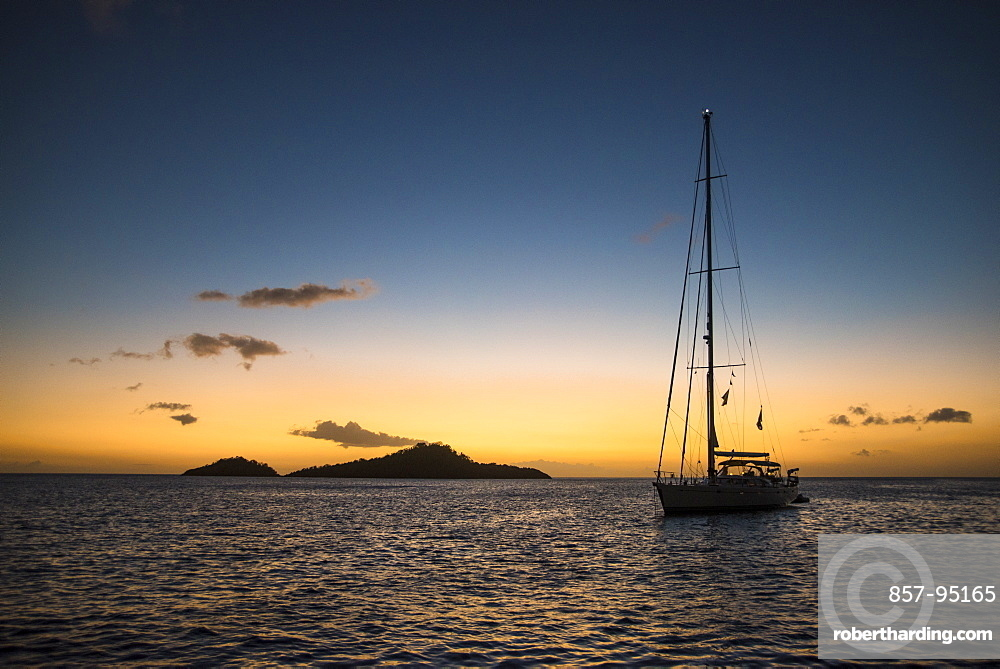 Silhouette of single sailboat in sea at sunset, Bouillante, Basse Terre, Guadeloupe