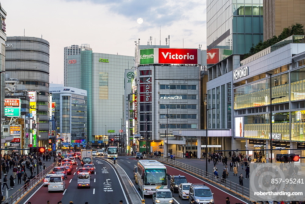 Street scene with traffic and pedestrians in the Shinjuku district of Tokyo, Japan
