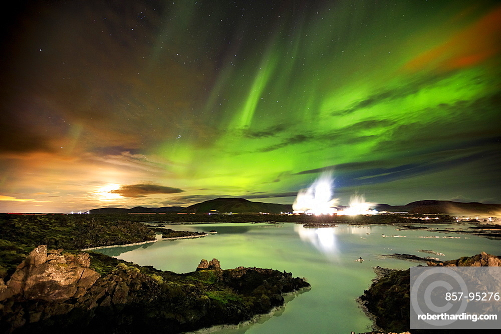 Majestic view of aurora borealis in sky at night over hot springs of Blue Lagoon, Iceland