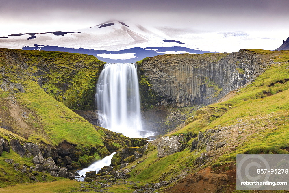 Majestic natural scenery with view of Svodufoss waterfall and Snaefellsjokull volcano, Iceland