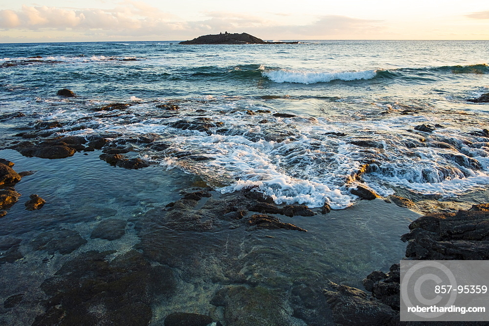 Sunset views with rocks and water from Halape Beach along the Puna Coast Trail in Hawaii Volcanoes National Park on the Big Island of Hawaii