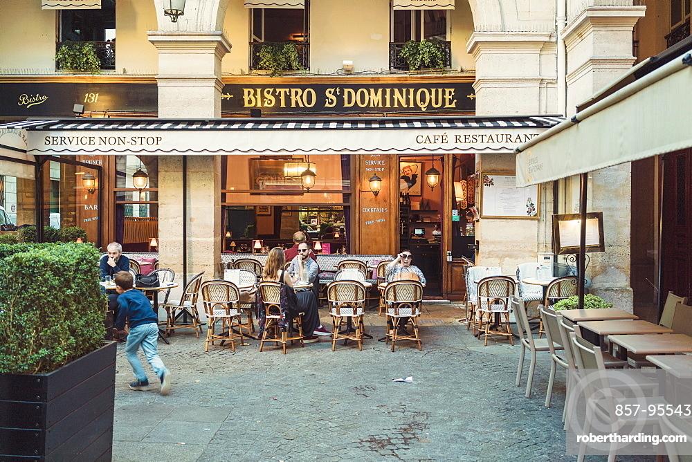 Front view of cafe at University street in Paris, Ile-de-France, France