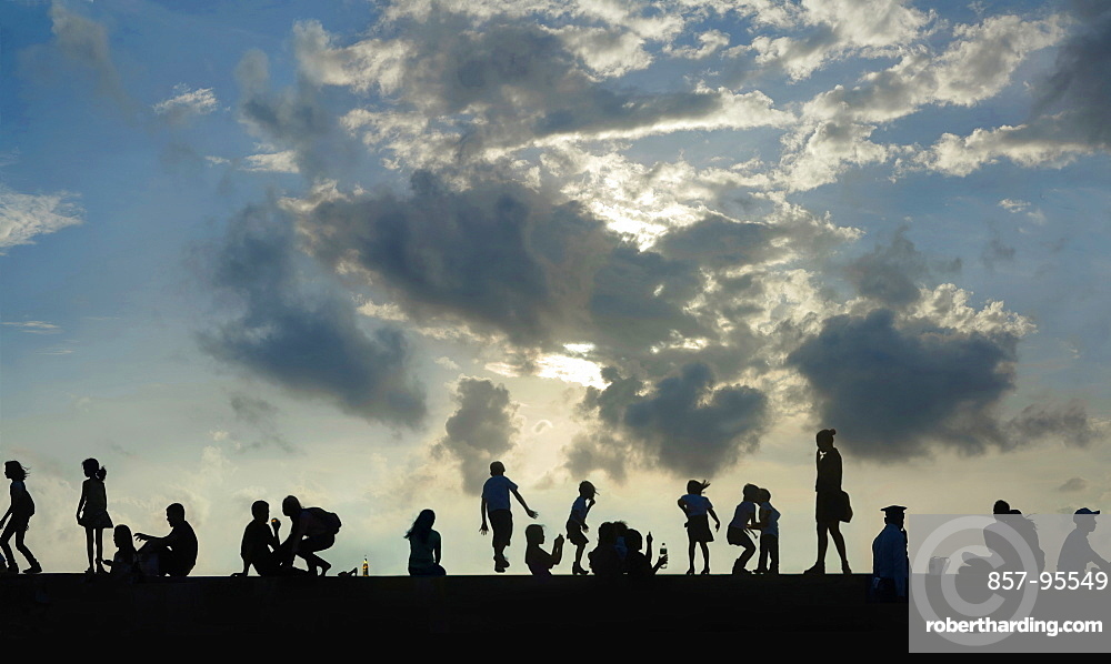 View of silhouettes of group of people against sky at sunset, Manila, Philippines