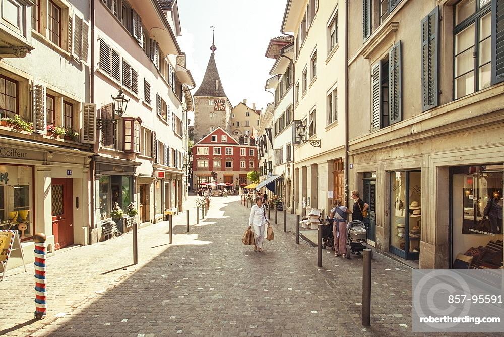 Scarce pedestrian traffic in picturesque of town street, Zurich, Switzerland