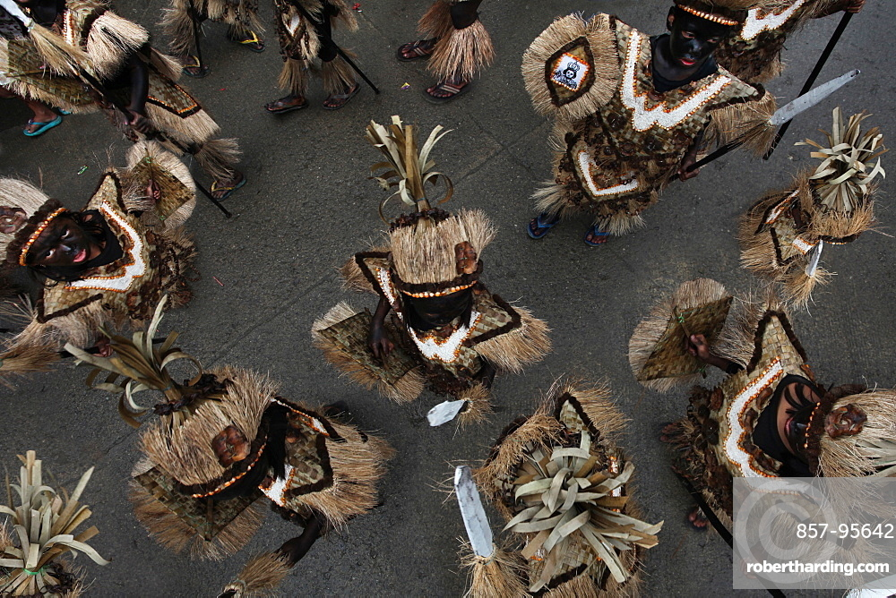 Children with black smeared faces in tribal costumes at Ati Atihan festival, Kalibo, Aklan, Panay Island, Philippines