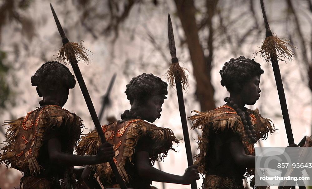 Three children wearing tribal African costumes on blurred background at Ati Atihan festival, Kalibo, Aklan, Panay Island, Philippines