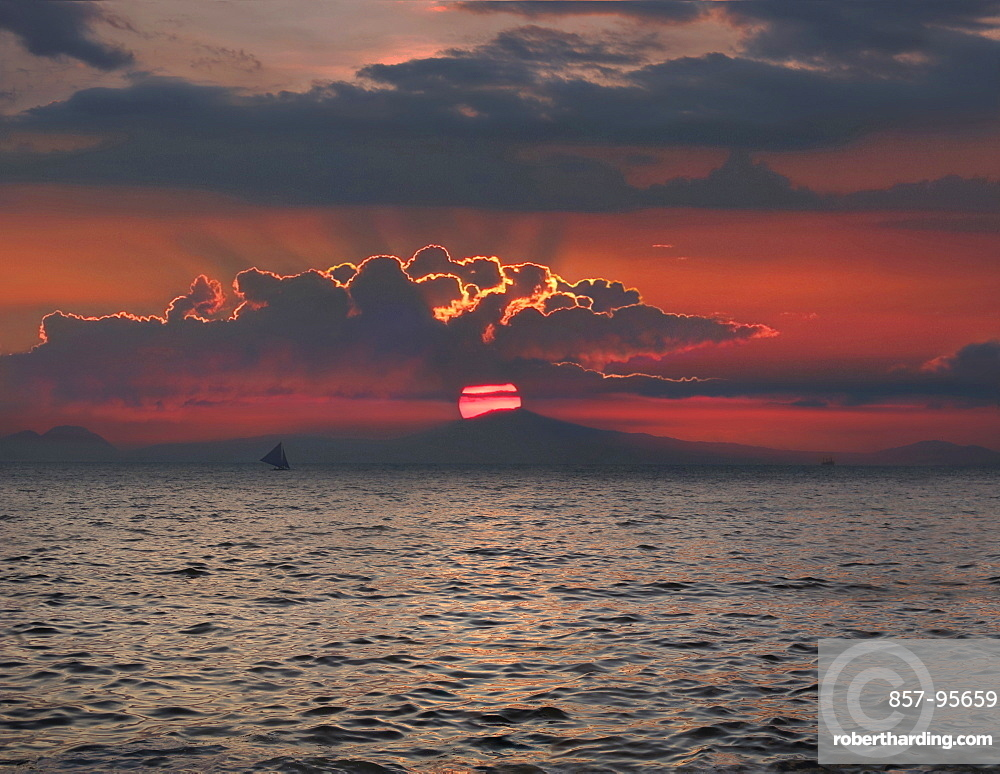 Distant view of silhouette of sailboat in sea at sunset, Boracay, Aklan, Philippines