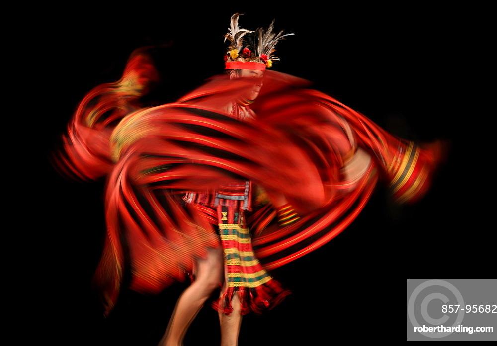 Ifugao tribesman dancing against black background, Banaue, Ifugao, Philippines