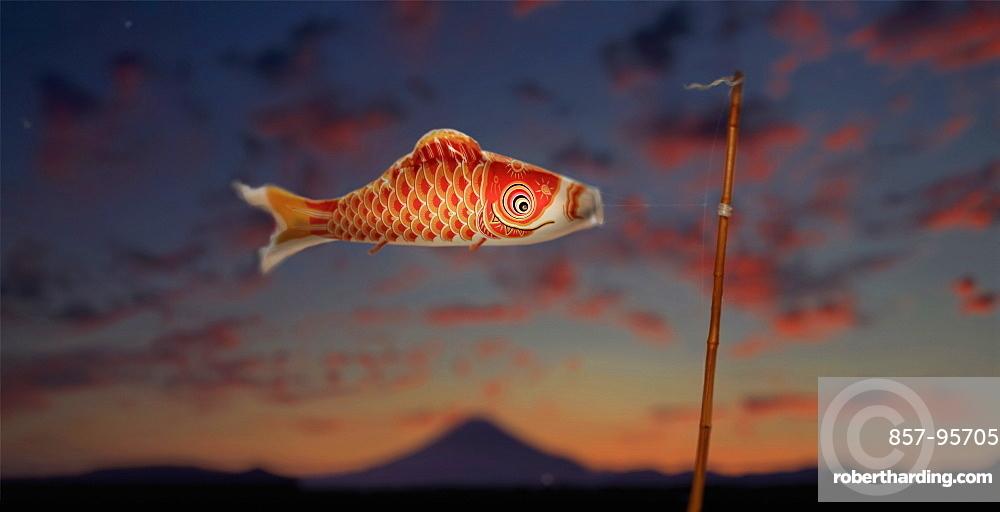 Carp streamer (koinobori) to celebrate children's festival on may 5 in front of Mount Fuji at sunset, Tokyo, Japan
