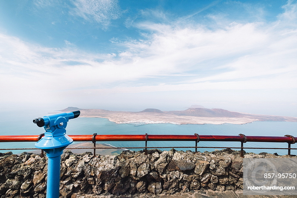 View of Mirador del Rio viewpoint binoculars with Island of La Graciosa in background, Mirador del Rio, Lanzarote, Spain