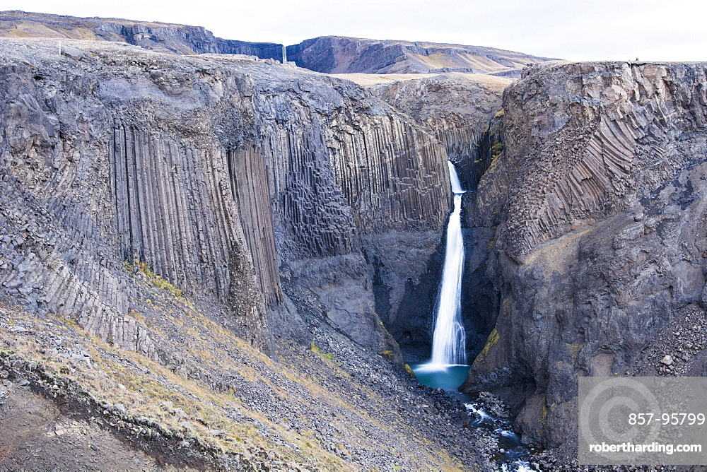 Scenic view of Litlanesfoss waterfall and surrounding cliffs of Hengifoss walking track, Iceland