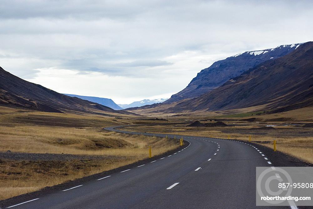 Empty Ring Road highway winding across mountain valley, Hringvegur, Iceland