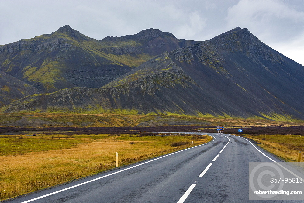 Empty Ring Road highway with black mountain in background, Borgarbyggd, Iceland
