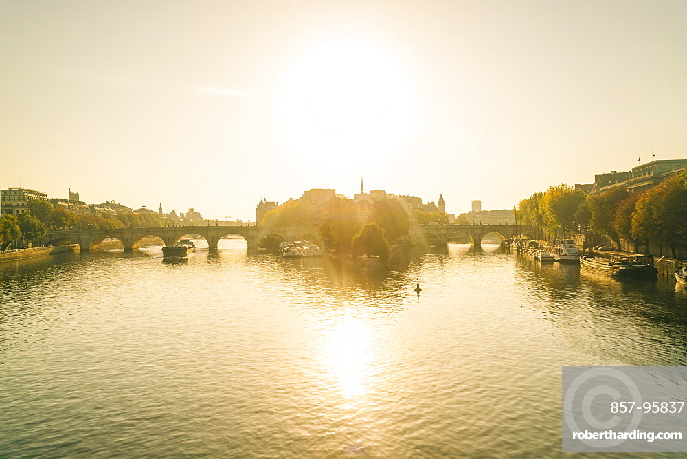 Sunrise on Seine River with Pont neuf or new bridge and isle de la cite where Notre Dame Cathedral is located, Paris, Ile-de-France, France