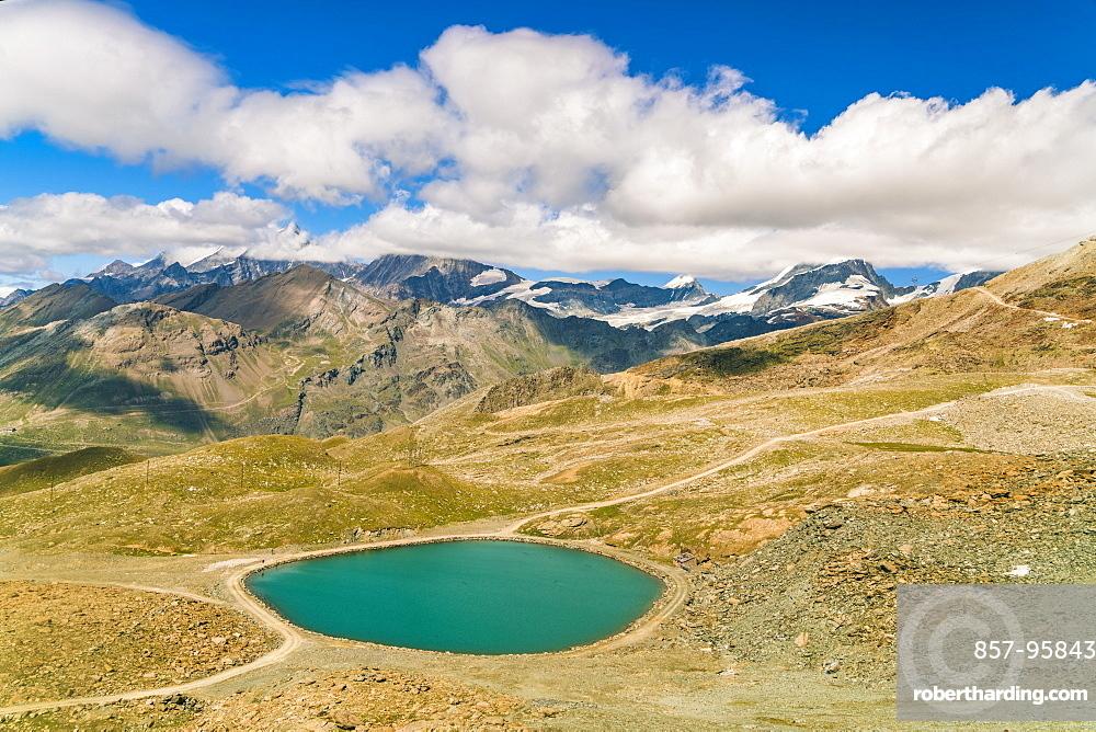 Mountainscape with lake, Rotenboden, Gornegrat summit and Matterhorn summit in background, Zermatt, Valais, Switzerland