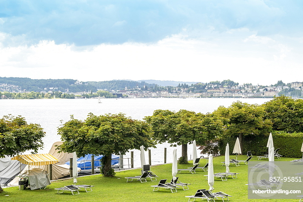 Landscape with Lake Zug , trees and beach chairs, Zug, Switzerland