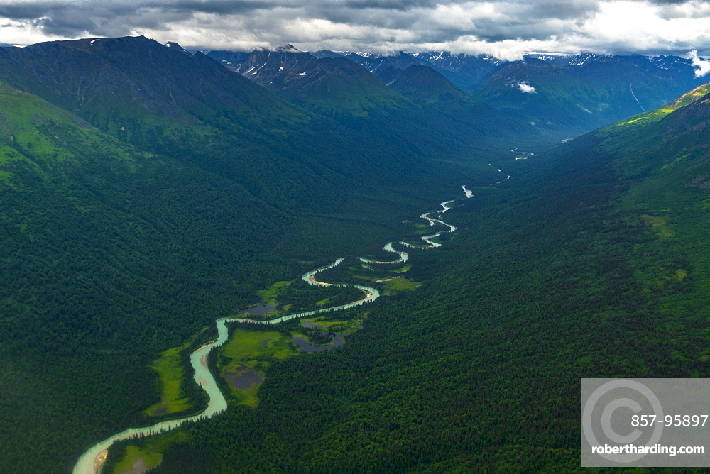 Majestic aerial view of natural scenery of Chugach Mountain range with glacier carved valley with river, Palmer, Alaska, USA