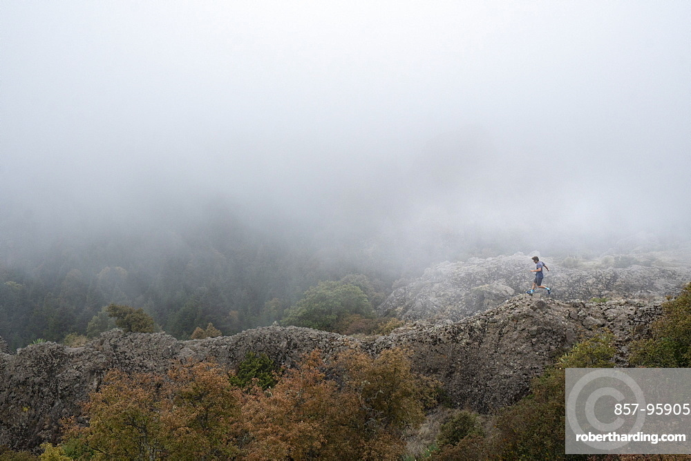 Man running on ridge in El Chico National Park, Hidalgo, Mexico