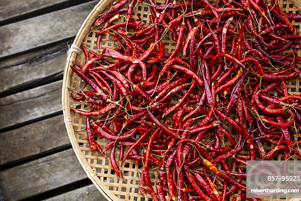 A basket of chilis sits on a dock on Myanmar's Inle Lake, one of the country's most popular tourist destinations