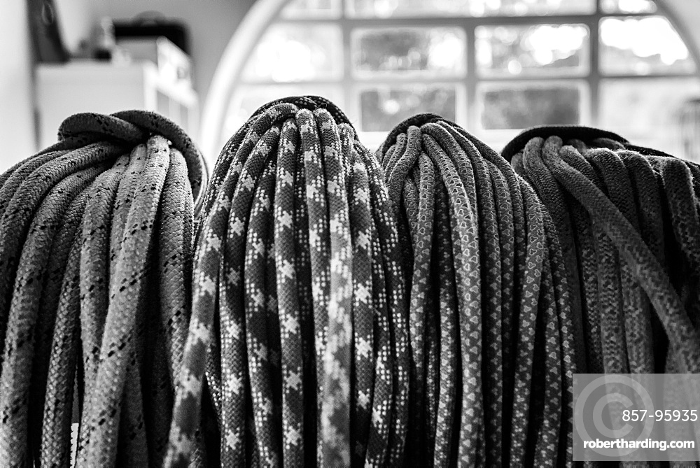Black and white picture of climbing ropes hanging on climbers bedroom, Cascais, Lisbon, Portugal