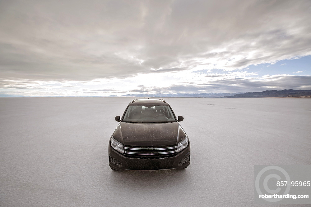 Front view of SUV parked on Bonneville Salt Flats, Wendover, Utah, USA