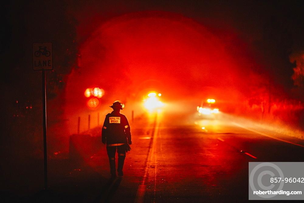 Firefighter walking the containment line, Pimpama, Queensland, Australia.