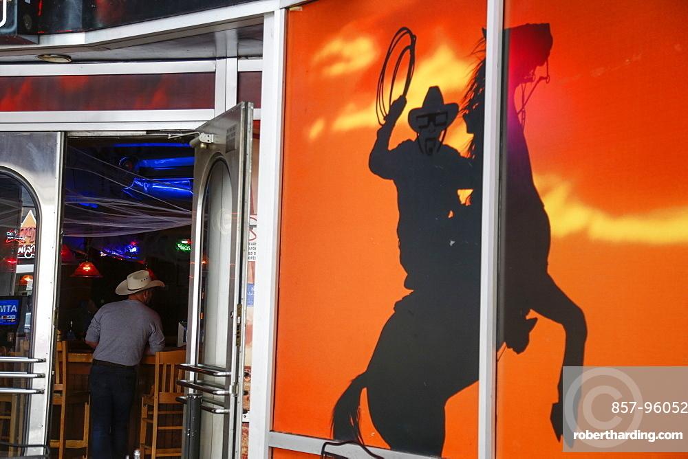 View of man behind door in cowboy hat in bar, Nashville, Tennessee, USA
