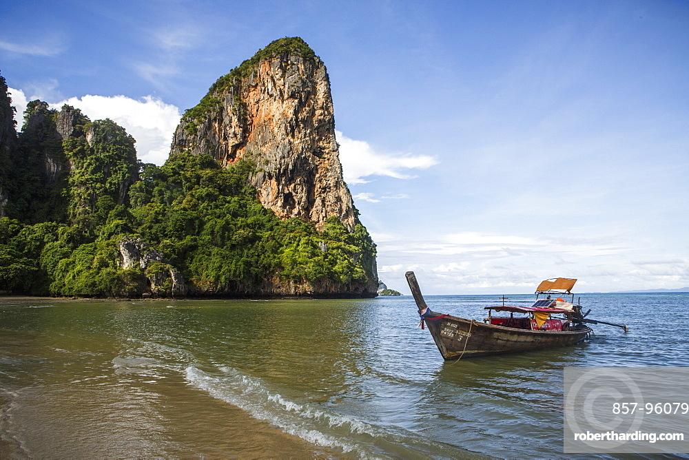 Railay Beach near Krabi, Thailand offers pristine ocean views on the Andaman Sea. The beach is a popular tourist destination located east of Phuket.
