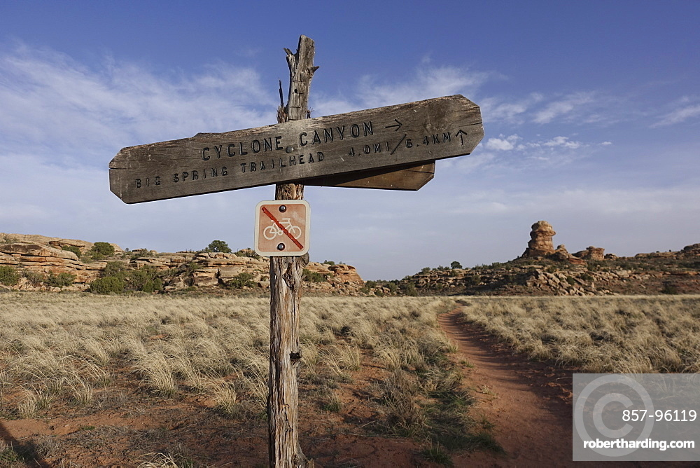 View of trail post with no bikes allowed sign in Canyonlands National Park, Utah, USA