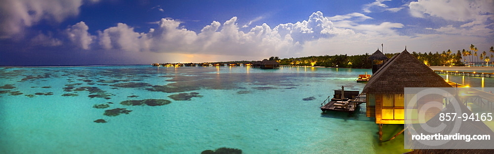 Panoramic view of over water villas under the moonlight at Gili Lankanfushi, in the Maldives