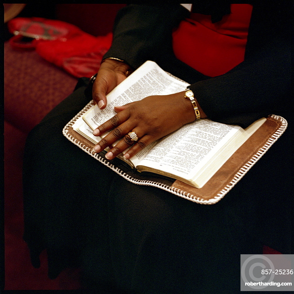 A woman rests her hand on a bible while listeing to a sermon about Covenant Marriage at Full Council Christian Fellowship in North Little Rock, Arkansas, on the sunday before Valentine's Day.