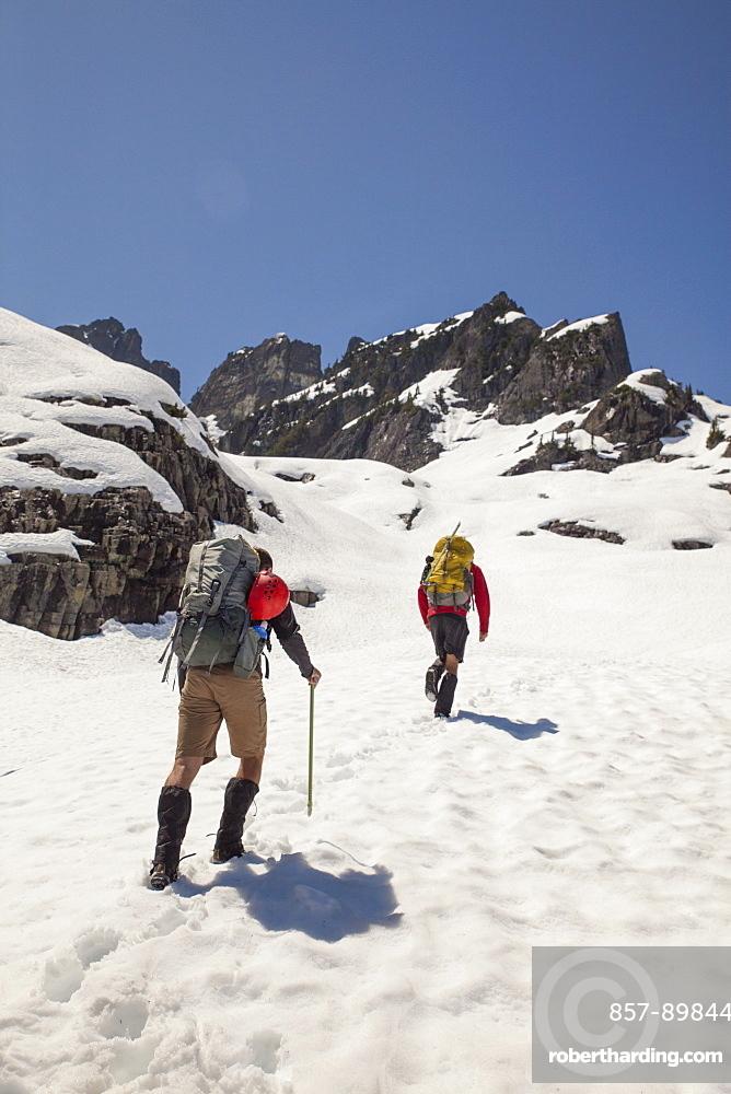 Two climbers approach Trio Peak in British Columbia, Canada.