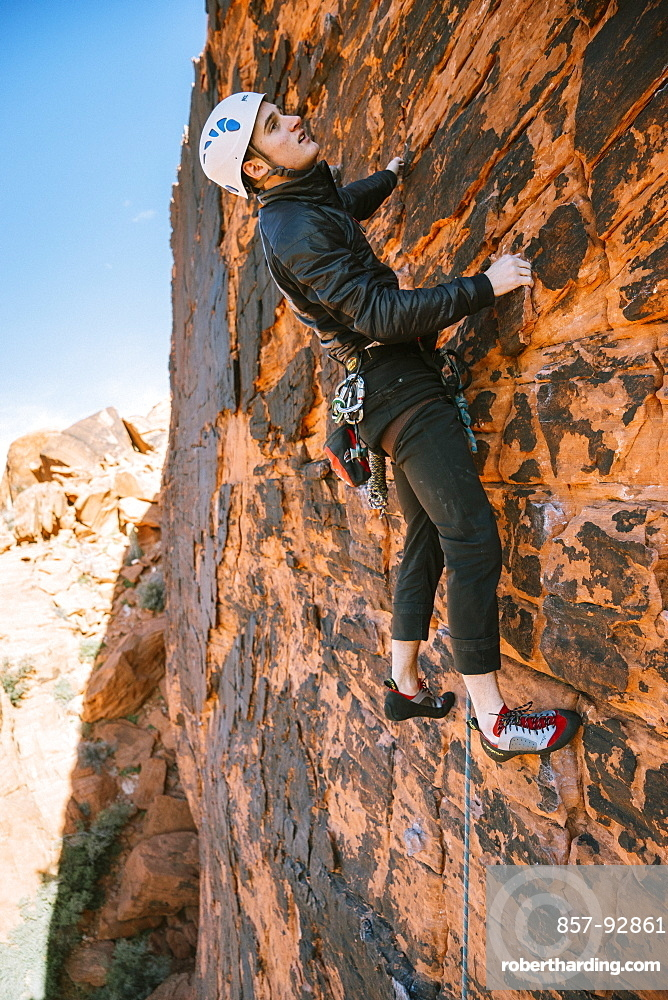 """A climber leading """"Brief Encounter"""" (5.8) on Panty Wall in Red Rock Canyon, Nevada"""