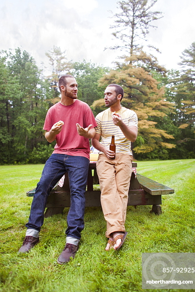 Two friends hang out at barbecue